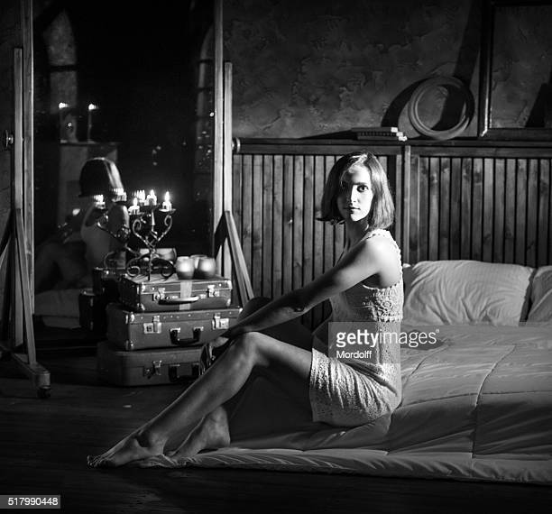 charming girl. portrait in bedroom - women in slips stock photos and pictures