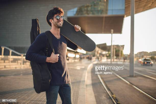charming guitarsit downtown - guitar case stock pictures, royalty-free photos & images