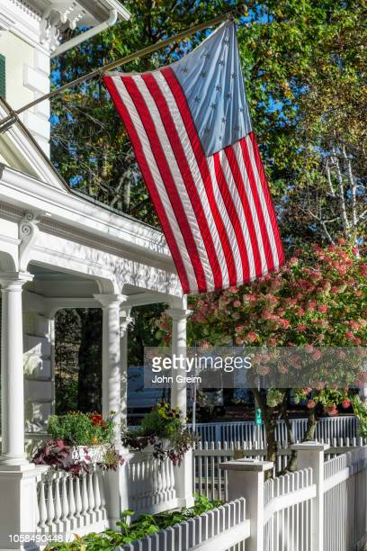 Charming home exterior with American flag