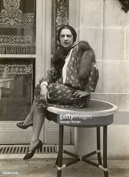 Charming home portrait just made of Mlle. Suzanne Lenglen, world's champion woman tennis player, taken in the garden of her Paris home. She is shown...