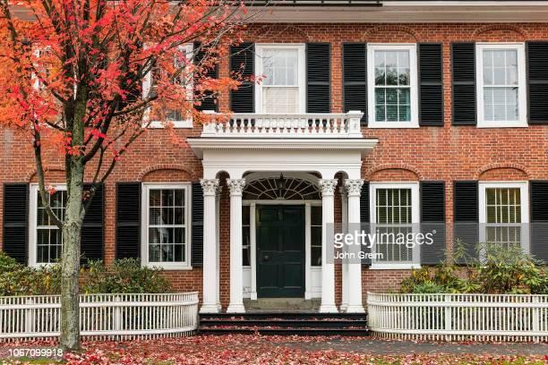 Charming house exterior with autumn foliage