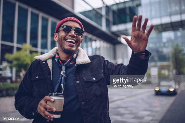 charming man waving - waving gesture stock photos and pictures