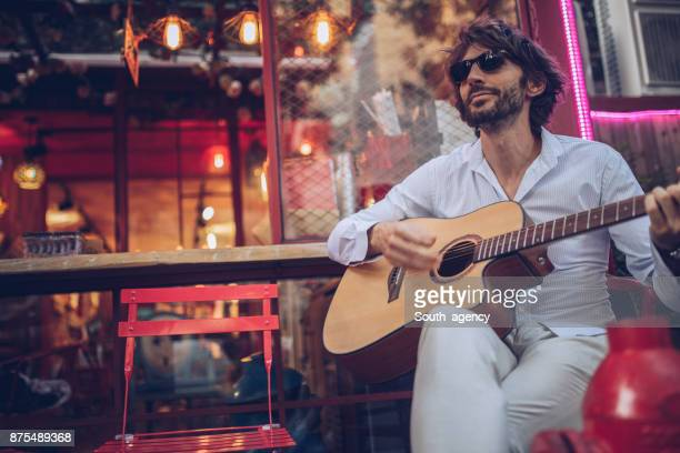 charming musician - busker stock pictures, royalty-free photos & images