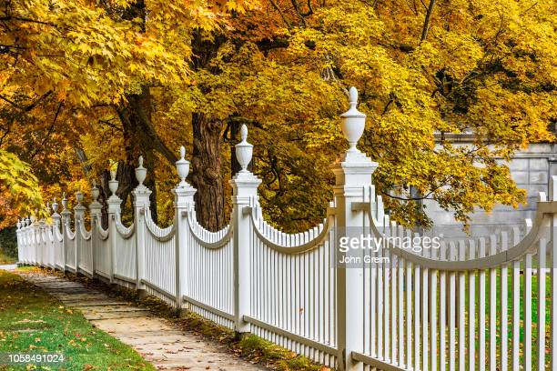 Charming New England picket fence with autumn foliage