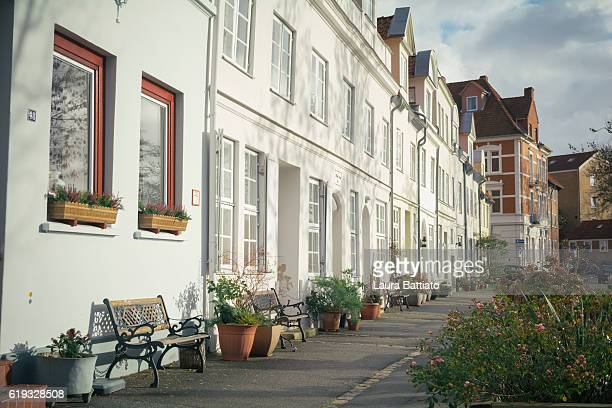 a charming street in the old town, lübeck, germany - geometrical architecture stock photos and pictures