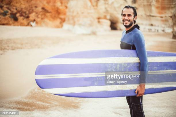 charming surfer - one man only stock pictures, royalty-free photos & images