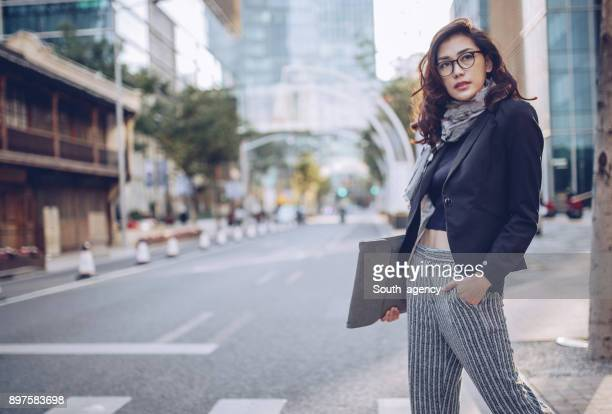 charming woman downtown - fashionable stock pictures, royalty-free photos & images
