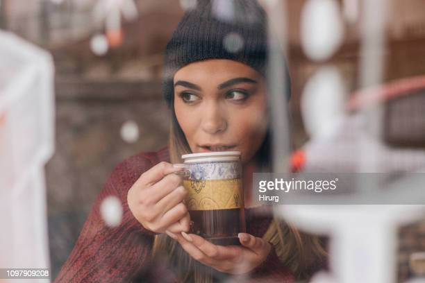 charming woman drinking tea - herbal tea stock pictures, royalty-free photos & images