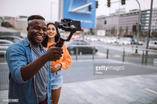 charming young people making video blog - influencer stock pictures, royalty-free photos & images