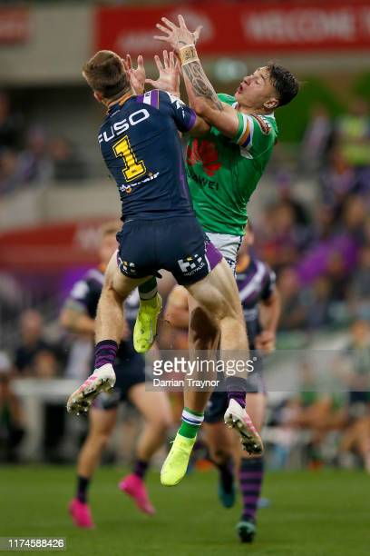 Charnze Nicoll-Klokstad of the Raiders and Ryan Papenhuyzen of the Storm compete for a high ball during the NRL Qualifying Final match between the...