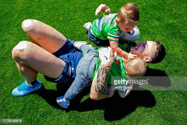 Charnze Nicoll-Klokstad of the Raiders plays with his children Rio 3, and Kyrie 1, after a Canberra Raiders Training Session & Media Opportunity at...