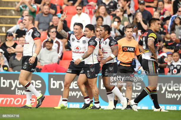 Charnze NicollKlokstad of the Warriors celebrates with his team mates after scoring a try during the round 10 NRL match between the Penrith Panthers...