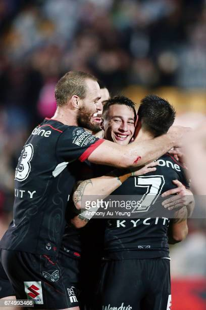 Charnze NicollKlokstad of the Warriors celebrates with teammates Shaun Johnson Simon Mannering and Ben Matulino after winning the round nine NRL...