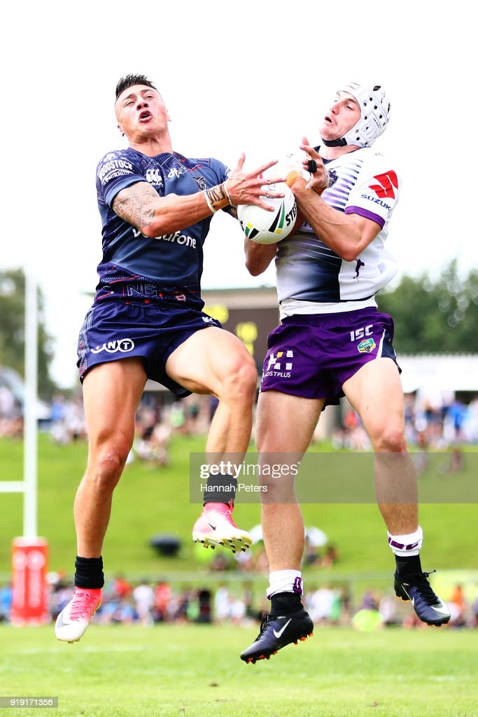 Charnze Nicoll-Klokstad of the Warriors competes with Matt Sopa-Lawler of Melbourne during the NRL trial match between the New Zealand Warriors and the Melbourne Storm at Rotorua International Stadium on February 17, 2018 in Rotorua, New Zealand.