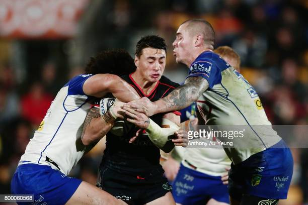 Charnze NicollKlokstad of the Warriors is tackled by Raymond FaitalaMariner and David Klemmer of the Bulldogs during the round 16 NRL match between...