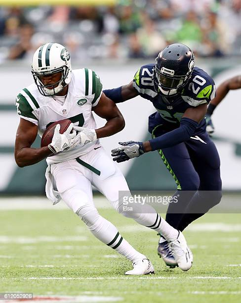 Charone Peake of the New York Jets makes a catch as Jeremy Lane of the Seattle Seahawks defends at MetLife Stadium on October 2 2016 in East...