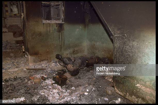 Charred bodies of Muslims burn in homes set aflame by Hindu mobs in rioting sparked by razing of Ayodhya Babri Mosque by militant Hindus