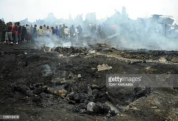 Charred human remains lie on the ground at the still smouldering scene of a fierce fire September 12 2011 following an explosion of a pipeline used...