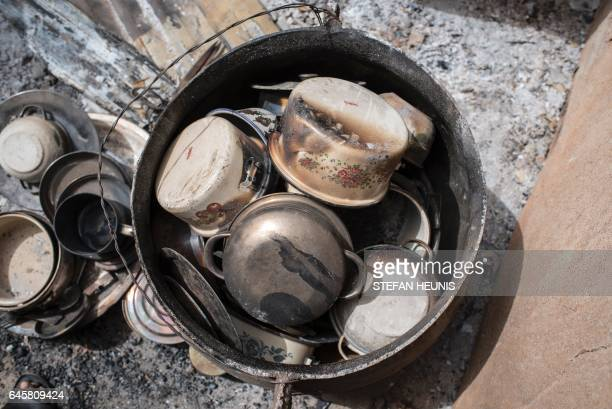 Charred pots in the village of Bakin Kogi in Kaduna state northwest Nigeria that was recently attacked by suspected Fulani herdsmen on February 24...