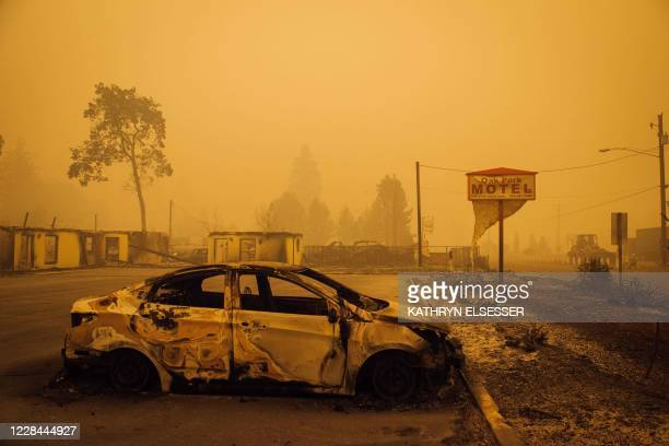 Charred vehicle is seen in the parking lot of the burned Oak Park Motel after the passage of the Santiam Fire in Gates, Oregon, on September 10,...