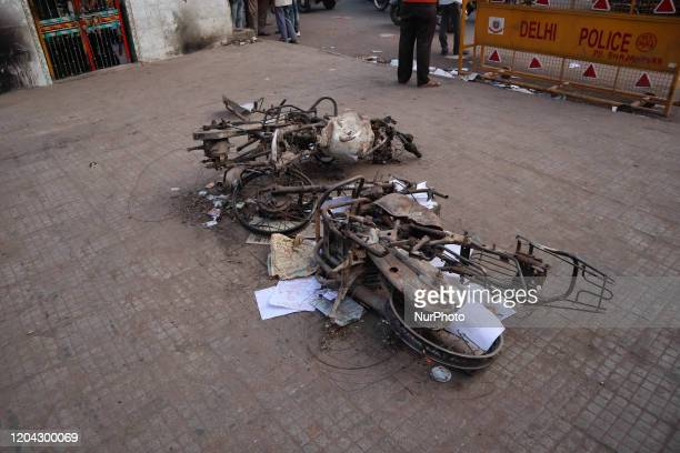 Charred vehicles on road after they were set on fire by a mob during riots in Chandbagh area of New Delhi India on 29 February 2020 More than 40...
