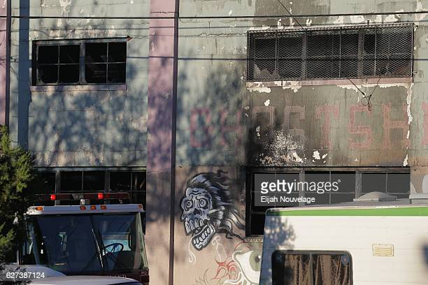 Charred windows on the face of a building that was the scene of a overnight fire that claimed the lives of at least nine people at a warehouse in the...