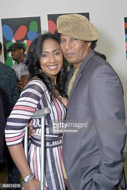 Charron Capri and Jesse Raudales attend Olympic Artist Jesse Raudales 'Peace for the Children' Art Show' at Los Angeles on February 9 2007