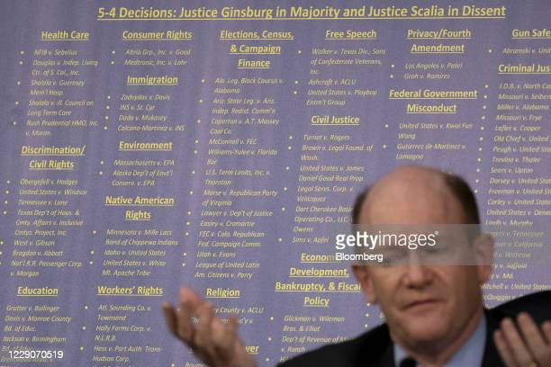 Chart is displayed behind Senator Chris Coons, a Democrat from Delaware, while speaking during a Senate Judiciary Committee confirmation hearing in...