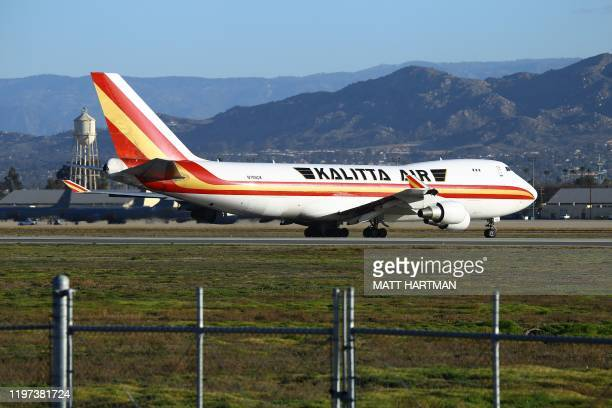 A charter plane lands at March Air Reserve Base in Riverside California on January 29 with passengers evacuated from Wuhan the Chinese city at the...