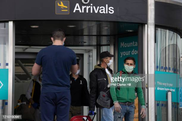 Chartered plane with Romanian seasonal workers arrives at London Stanstead Airport to fill the shortfall in workers to pick fruit and vegetables from...