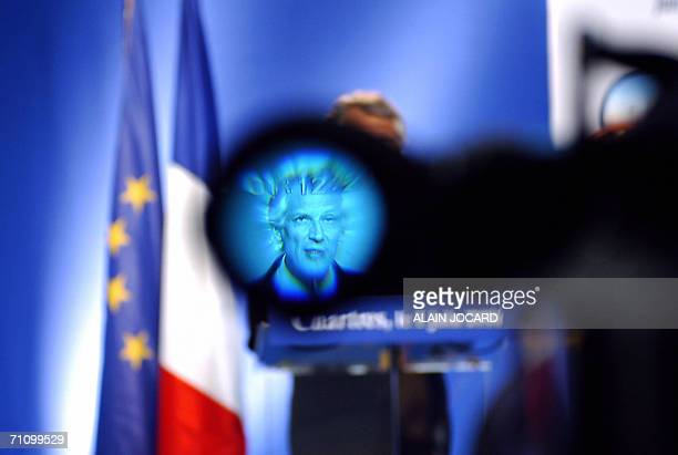 French Prime Minister Dominique de Villepin is seen through the eyepiece of a camera as he gives a speech during his monthly press conference 01 June...