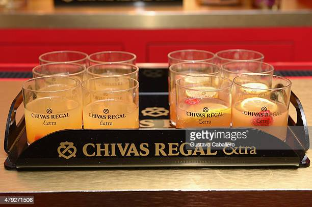 Charttopping band Mana and guests enjoy Chivas Regal Extra cocktails backstage before performing at American Airlines Arena on the Miami stop of...