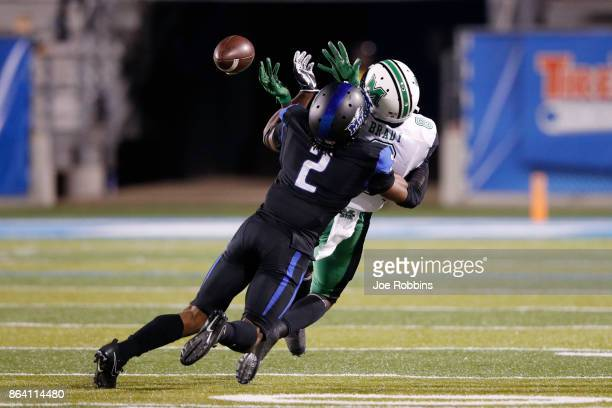 Charvarius Ward of the Middle Tennessee Blue Raiders defends a pass intended for Tyre Brady of the Marshall Thundering Herd in the third quarter of a...