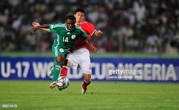 Charyl Chappuis of Switzerland battles with Sani Emmanuel of Nigeria during the FIFA U17 World Cup Final match between Switzerland and Nigeria at the...
