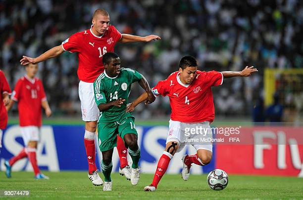 Charyl Chappuis of Switzerland holds off Sani Emmanuel of Nigeria during the FIFA U17 World Cup Final match between Switzerland and Nigeria at the...