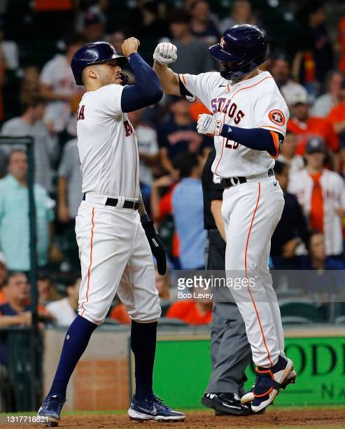 Chas McCormick and Carlos Correa of the Houston Astros celebrate after McCormick's three-run home run in the eighth inning against the Los Angeles...