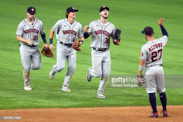 Chas McCormick, Jake Meyers, and Kyle Tucker celebrate the win with Jose Altuve of the Houston Astros over the Texas Rangers at Globe Life Field on...