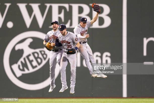Chas McCormick, Kyle Tucker, and Myles Straw of the Houston Astros celebrate after a win over the Boston Red Sox at Fenway Park on June 9, 2021 in...