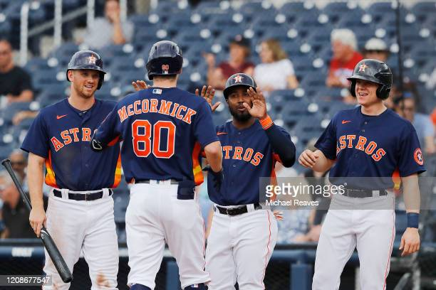 Chas McCormick of the Houston Astros celebrates with teammates after hitting a grand slam against the Miami Marlins during the sixth inning of a...