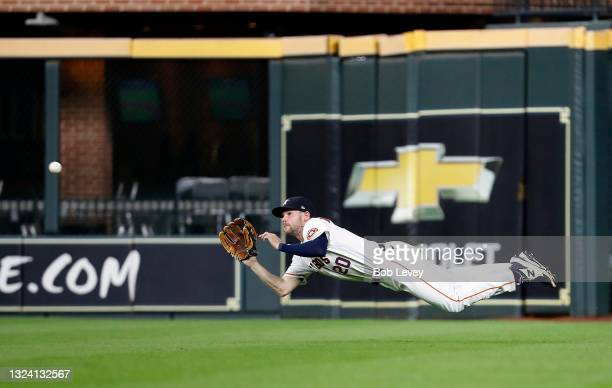 Chas McCormick of the Houston Astros makes a diving catch on a line drive off the bat of Danny Mendick of the Chicago White Sox in the third inning...