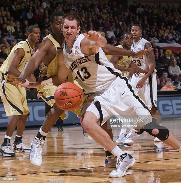 Chas McFarland of the Wake Forest Demon Deacons loses control of the ball while being defended by the Georgia Tech Yellow Jackets at the LJVM...