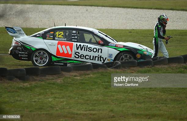 Chas Mostert driver of the Dick Johnson Racing Ford walks from his car after a collision with Russell Ingall driver of the Supercheap Auto Racing...