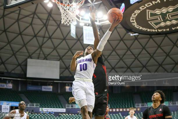 Chase Adams of the Portland Pilots attempts to lay the ball in ahead of Chris Harris Jr. #1 of the Houston Cougars during the second half at the Stan...