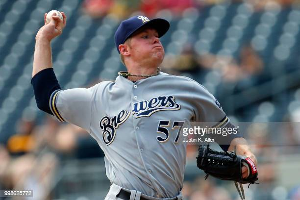 Chase Anderson of the Milwaukee Brewers pitches in the first inning during game one of a doubleheader against the Pittsburgh Pirates at PNC Park on...