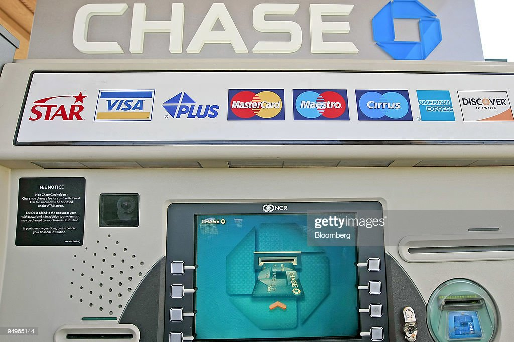 A Chase ATM stands outside a JPMorgan Chase & Co  bank branch in