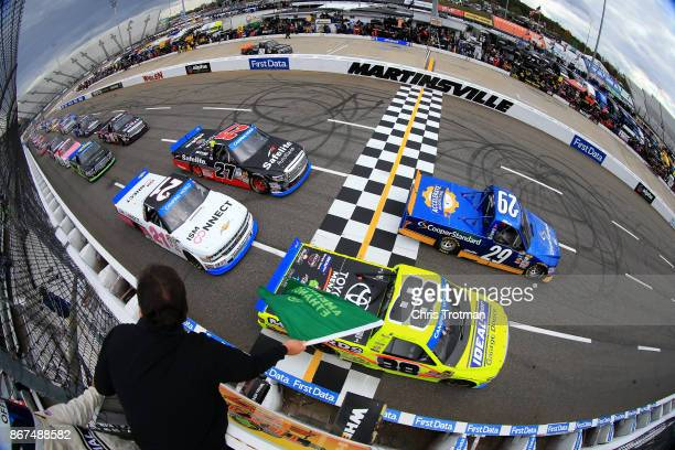 Chase Briscoe driver of the Cooper Standard Ford and Matt Crafton driver of the Ideal Doors/Menards Toyota lead the field to the green flag to start...