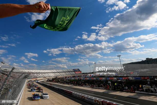 Chase Briscoe driver of the Cooper Standard Ford and Ryan Truex driver of the SeaWatch Toyota lead the field to the green flag to start the NASCAR...