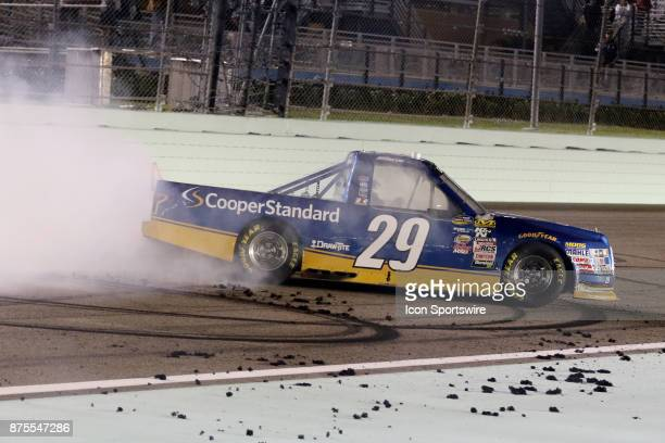 Chase Briscoe driver of the Cooper Standard Ford celebrates winning the Ford EcoBoost 200 at HomesteadMiami Speedway on November 17 2017 iin...