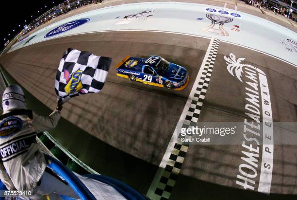 Chase Briscoe driver of the Cooper Standard Ford crosses the finish line to win the NASCAR Camping World Truck Series Championship Ford EcoBoost 200...