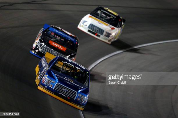 Chase Briscoe driver of the Cooper Standard Ford leads a pack of trucks during the NASCAR Camping World Truck Series JAG Metals 350 Driving Hurricane...